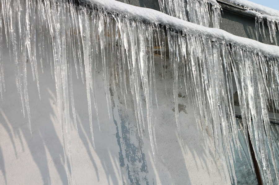 Icicles hanging from wires
